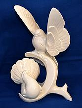 ROYAL DOULTON ''THE HOMECOMING''  From Images of Nature Series 2 White Doves on Branch.  15 3/4''H.  11''W. 10''D. Mark, Royal Doulton Images of Nature HN3532. Condition, age appropriate wear. Missing wooden base. Item sold as is.