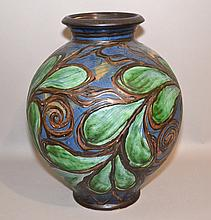 DANISH POTTERY VASE Hand thrown danish pottery vase. Polychrome raised outline leaf and scroll pattern. 15 1/2''H. 6 1/2''diam.top. 13''diam.widest part. 5 3/4''diam.base. Mark, stamped denmark and incised calligraphic mark. Condition, age