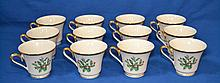 LENOX CUPS HOLIDAY PATTERN LOT 12 PIECES   12 Cups with holly and gilt band decoration.  3''H. 3 1/2''diam.top. Mark, Dimension Collection Lenox Holiday Made in USA. Condition, age appropriate wear.
