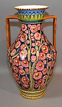 ITALIAN POTTERY VASE  Italian pottery. 2 Handled Vase. Bright polychrome floral decoration. 13 1/2''H.  Mark, Italy.  Condition, age appropriate wear. All items sold as is. (chip and repair to top rim)