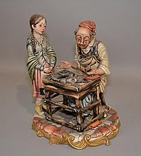 CAPODIMONTE COBBLER GROUP  Polychrome porcelain. Group of cobbler and young girl.  9 3/4''H.  Mark, crown over N. Condition, age appropriate wear.