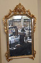 GILT GESSO MIRROR  Mirror 22''x40'' Condition, age appropriate wear. Item sold as is. (missing pieces on bottom).