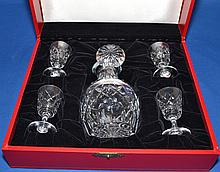 CARTIER CRYSTAL CORDIAL SET  Includes, decanter and stopper with (4) four cordial glasses. Stamped, ''Cartier''. In signature cartier gift presentation box. Condition, age appropriate wear.