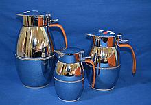 (3)HERMES THERMAL CARAFES  Silver with decorative leather handles. Comes in three sizes. 10''H., 7 1/2''H. and 6''. Mark, Hermes Paris, Made in France. Condition, age appropriate wear. Items sold as is.