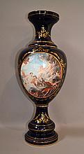 COBALT PORCELAIN URN  Large cobalt porcelain urn form vase. Front decaled scene in the manner of boucher. 32 1/2''H. 9''diam.base. Mark, Kobalt K Stilesevres. Condition, age appropriate wear.