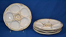 4 LIMOGES OYSTER PLATES  4 Theodore Haviland oyster plates with green and gilt trim. 8 1/4''diam. Mark, Theodore Haviland Limoges France. Condition, age appropriate wear.