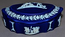 WEDGWOOD JASPERWARE LIDDED CONTAINER Late 19Th.Century - Early 20Th.Century Dark Blue and White Jasperware Container. Shaped oval form with domed lid. Classical cartouches and leaf frieze. Mark, Impressed Wedgwood England. Condition, age appropriate