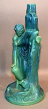 VAN BRIGGLE FIGURAL POTTERY  Blue glaze Van Briggle Pottery Group. Woman by tree with vase.  6 1/2''H.  Mark, Van Briggle Colo Spgs, Colo.  Condition, age appropriate wear. Items sold as is.