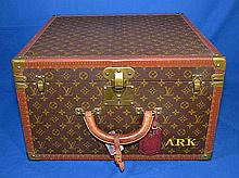 LOUIS VUITTON SQUARE FORM SUITCASE. Vintage square form hard side luggage, leather lined, liftout lattice bottom shelf. Marked; Louis Vuitton 925140 Ave Marceau 78 Paris, Nice 2 Ave Gustave V. Size: 11 3/4''H, 19 1/2'' x 19 1/2''. Condition: age