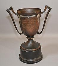 SILVER CREST GROGAN GOLF TROPHY Copper loving cup trophy with sterling details. Inscribed ''Grogan Golf Trophy Shannopin Country Club versus Highland Country Club. To be won three times for possession''. Verso Winner Pro Team 1926 - 1927 Comes with