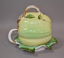 KUZNETSOV MELON FORM LIDDED CONTAINER  Imperial Russian Kuznet Sov porcelain covered bowl. Melon form with attached leaf form underplate. 6''H. 6''L. 5 1/2''W. Mark, Kuznet Sov 19th.c.mark. Condition, age appropriate wear. (wear to gilt).