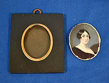 IVORY PORTRAIT MINIATURE. 19th c. oval ivory portrait of a young lady, rectangular ebonized wood frame with gilt brass fillet. No mark. Size; ivory: 2 1/4''H, 1 5/8''W. frame: 3 1/2''H, 3''W. Condition; no glass, noose in frame, crack on ivory.