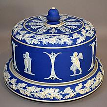 ADAMS BLUE&WHITE; JASPERWARE CAKE PLATE AND COVER  Adams blue and white jasperware cake plate with cover. Beautifully decorated with Oakleaf Band, Putti, and Classical Trim. 8''H. 10 3/4''diam.base. No Mark. Condition, age appropriate wear.