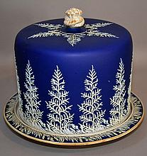19Th.CENTURY BLUE&WHITE; JASPERWARE CHEESE DOME Blue and White Jasperware Cheese Dome. Footed base. Dome with rope knot finial. Body decorated with continuous fern pattern. 8 1/2''H. 10''diam. Mark, Lid inscribed ''184'' Base unmarked. Condition, age
