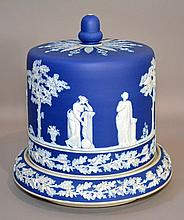 WEDGWOOD TYPE BLUE&WHITE; JASPERWARE CHEESE DOME Dark Blue and White Jasperware Cheese Dome. Decorated with two oak leaf and acorn bands. Frieze of Classical Figures in Landscape. Acorn Finial Top with Dellcate Belle Flowers and Leaves. 12''H. 11