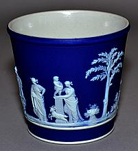 WEDGWOOD JASPERWARE BEAKER  Dark Blue and White Beaker. Frieze of Classical Figures Decoration. 3 1/4''H. 3 1/2''diam.top  2 1/2''diam.base.  Mark, Wedgwood Made in England.  Condition, age appropriate wear.