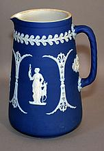 WEDGWOOD BLUE&WHITE; JASPERWARE PITCHER  Dark Blue Jasperware Pitcher. Classical Figures and designs. Rope twist handle.  7''H. Mark, impressed Wedgwood England.  Condition, age appropriate wear. (small stain on top rim)