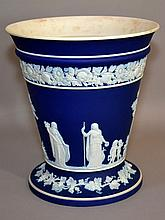 WEDGWOOD BLUE&WHITE; JASPERWARE VASE 20Th. Century Wedgwood Jasperware Vase. Lower Grape Vine Band. Upper Floral Band. Center Classical Frieze. 8''H. 7 1/2''diam.top. 6''diam.base. Mark, Wedgwood Made in England. Condition, age appropriate wear.