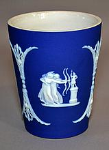 WEDGWOOD JASPERWARE BEAKER  Late 19Th.Century - Early 20Th.Century Wedgwood Dark Blue Jasperware Beaker with classical cartouches.  4''H. 3 1/4''diam.top. 2 1/4''diam.base. Mark, Wedgwood England. Condition, age appropriate wear.