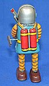 TIN LITHO WIND UP ROBOT. Wind up robot with ray gun. No mark. Size; 7''H. Condition: all mechanical devises sold as is.