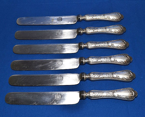 6 RUSSIAN STERLING HANDLED KNIVES. No monogram. Marked: S & Co. 84 hallmark. blades also marked. Size; 10 1/2''L. Condition; age appropriate wear.