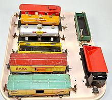 (8) ASSORTED LIONEL CARS - including: #1682 red caboose; #1680 Shell Oil car; #652 yellow Condola; #654 gray Sunoco Tank car; (2) #1679 Baby Ruth boxcars; #902 green Gondola and #3659 Automatic dump car - Condition: Age appropriate wear; All items