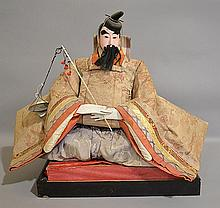ANTIQUE JAPANESE DOLL  Japanese Scholar Doll dressed in a Embroidered Robe. 19''H. 22''L. 10''W. Condition, age appropriate wear. All items sold as is.