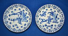 PAIR QING DYNASTY KANGXI (1662-1722) CHINESE PORCELAIN BLUE & WHITE CIRCULAR SAUCER DISHES - Fine pair chinese circular saucer dishes each of molded form with lappets beneath a foliate rim, the centers painted with two ladies and a boy in a fenced