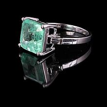 9ct white gold, emerald and diamond ring with claw