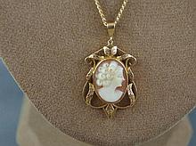 14ct yellow gold chain with 9ct gold cameo
