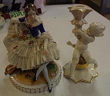 German lace figure of a musician along with cherub