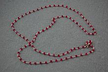 Fine ruby and silver matinee length necklace
