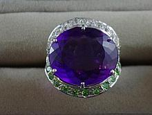Amethyst and green garnet ring set in silver set