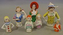 Seven various vintage half dolls