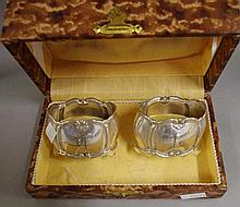 Two Italian sterling silver napkin rings in original box.