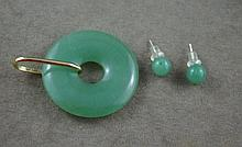 Good 14ct gold and jade pendant together with a