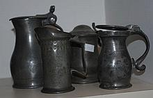 Four small antique pewter pitchers
