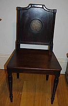 A rare George III mahogany hall chair with bronze