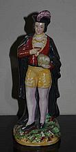Staffordshire pearlware figure of gentleman hand m