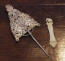 Asian silver pin together with bone book mark