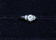 18ct white gold and diamond ring includes a 50