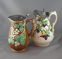 Two 19th century pottery jugs with pewter lids,