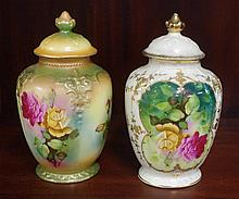 Two European porcelain lidded urns decorated with