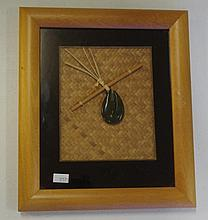 Framed New Zealand greenstone hook pendant