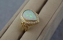18ct gold, Australian solid opal & diamond ring