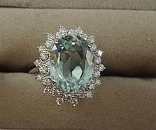 14ct white gold, diamond and aquamarine ring oval