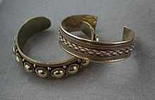 Two silver bangles including Siam sterling