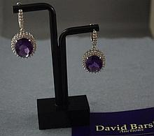 Pair of silver and oval amethyst earrings