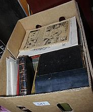 Box of old books and postcards