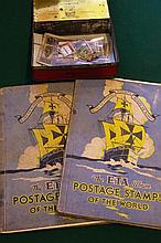 Two stamp albums together with a tin of stamps,